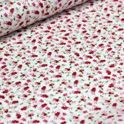 Beschichtete Baumwolle Streublümchen auf weiß